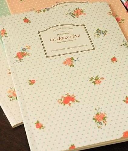 Schreibheft Rosen weiss liniert Dots